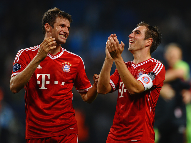 hi-res-182937487-thomas-muller-and-philipp-lahm-of-fc-bayern-muenchen_crop_650